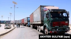Trucks carrying supplies for NATO's Resolute Support mission wait for clearance on Pakistan's border with Afghanistan in June.