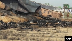 Charred bodies littered the scene after the tanker exploded.