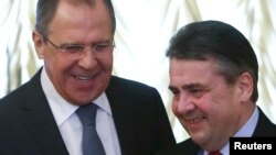 Russian Foreign Minister Sergei Lavrov (left) meets with German counterpart Sigmar Gabriel in Moscow on March 9.