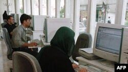 Surfing the Internet at a cafe in Tehran