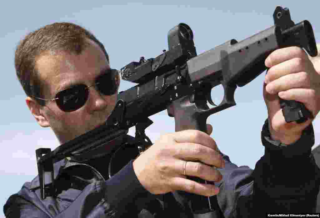 In another photo opportunity, Medvedev takes aim as he visits the Federal Security Service (FSB) Special Task Center in Russia's southern region of Daghestan on June 9, 2009.