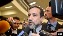 Iranian Deputy Foreign Minister Abbas Araqchi opposes the bill and says Tehran would never allow threats to influence the nuclear talks.