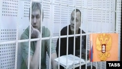 Станислав Клых и Николай Карпюк (слева направо), во время рассмотрения апелляции на приговор, 26 октября 2016 года