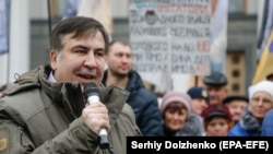 Former Georgian President and Odesa's ex-Governor Mikheil Saakashvili speaks to his supporters during a rally outside the Ukrainian parliament in Kyiv on November 7.