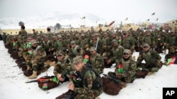 FILE: Afghan Army commandos attend their graduation ceremony after a training program at the Commando Training Center, on the outskirts of Kabul in January.