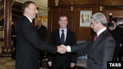 Russia -- President Dmitry Medvedev (C) at a meeting with his Armenian and Azerbaijani counterparts Serzh Sarkisian (R) and Ilham Aliyev in Sochi, 23Jan2012