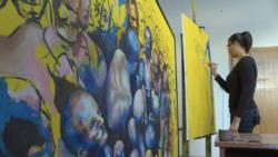Me pikturë përtej barrierave
