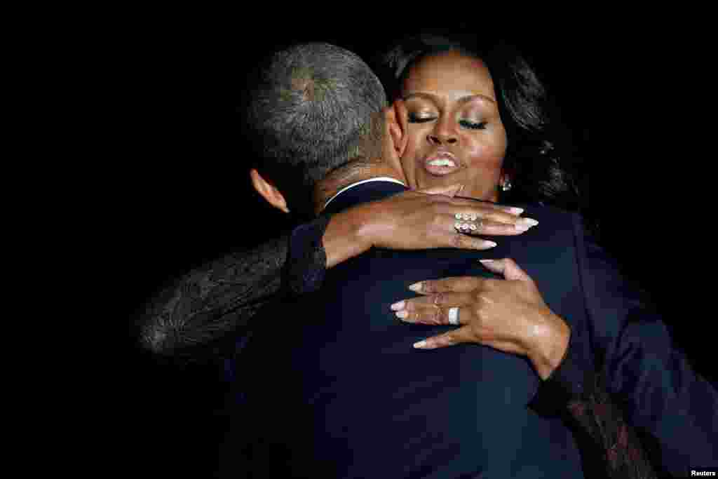 U.S. President Barack Obama embraces his wife Michelle Obama after his farewell address in Chicago, Illinois, on January 10. (Reuters/Jonathan Ernst)