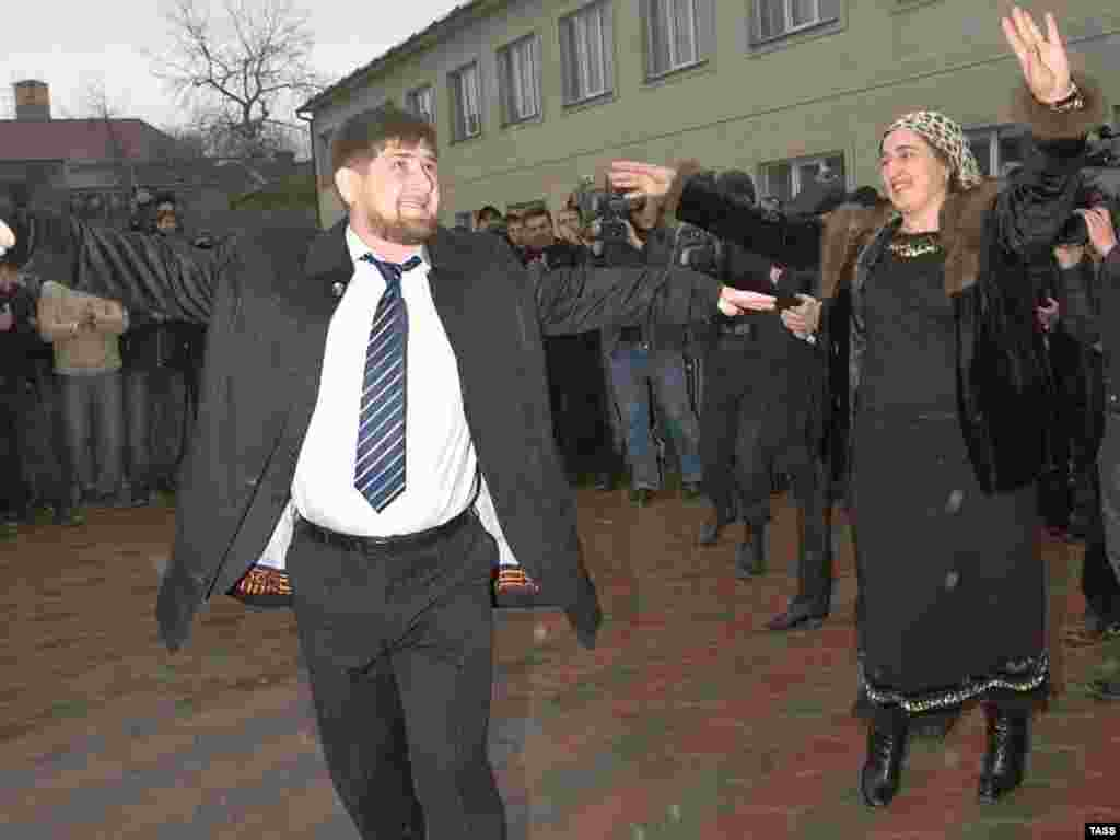 Elections often seem to put a spring in the Chechen leader's step. Here, Kadyrov dances after voting at the polling station in his clan's village during Russian State Duma elections in December 2007.