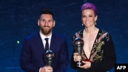 Best FIFA Men's Player of 2019, Argentina and Barcelona forward Lionel Messi (L) and Best FIFA Women's Player of 2019, US and Reign FC midfielder Megan Rapinoe pose at the end of The Best FIFA Football Awards ceremony, on September 23, 2019 in Milan.