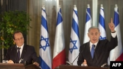 French President Francois Hollande with Israeli Prime Minister Benjamin Netanyahu during a joint press conference in Jerusalem on November 17.