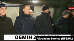 Screen capture of Stanislav Aseyev (2nd from left) during the prisoner exchange in eastern Ukraine