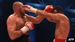 Wladimir Klitschko (right) of Ukraine in his first fight against Britain's Tyson Fury for the heavyweight championship in November.