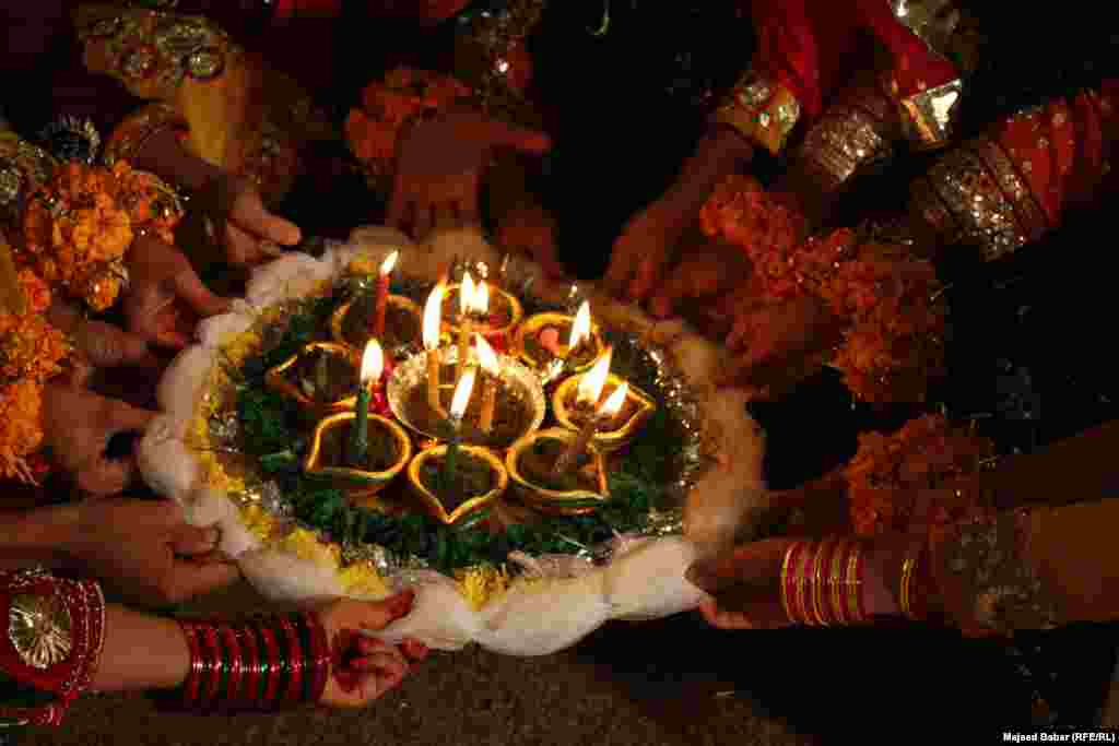 Candles, henna, flowers and colorful attire are in abundance.