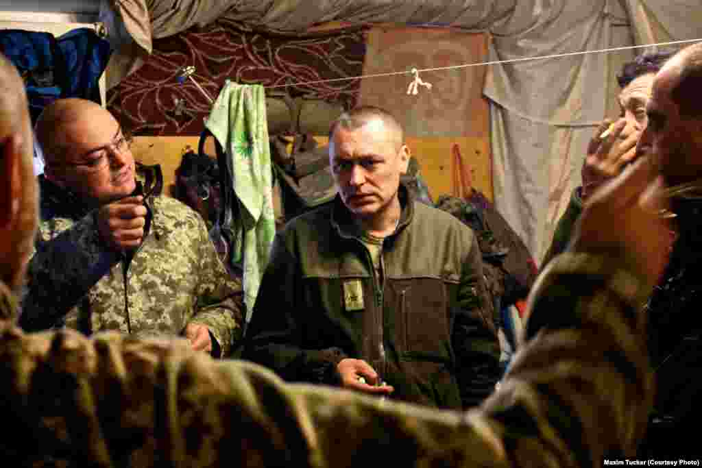 Officers get an update on clashes and enemy activity during a briefing at a command post in Pisky, eight kilometers from Avdiyivka on the southern flank of the battle. April 2, 2016