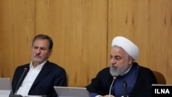 Iran - President Hassan Rouhani (R) and VP Es'haq Jahangiri in government cabinet meeting. August 14, 2019