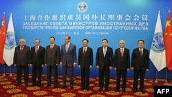 Foreign ministers of the Shanghai Cooperation Organization member states pose for a group photo before a council meeting of foreign ministers at the Diaoyutai State Guesthouse in Beijing on May 11.