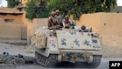 Ushtarët e Pakistanit gjatë një operacioni kundër militantëve talibanë