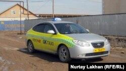Такси на одной из улиц Алматинской области. Иллюстративное фото.