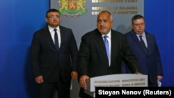 Bulgarian Prime Minister Boyko Borisov (center) speaks next to chief prosecutor Sotir Tsatsarov (right) and Interior Minister Mladen Marinov in Sofia on October 10.