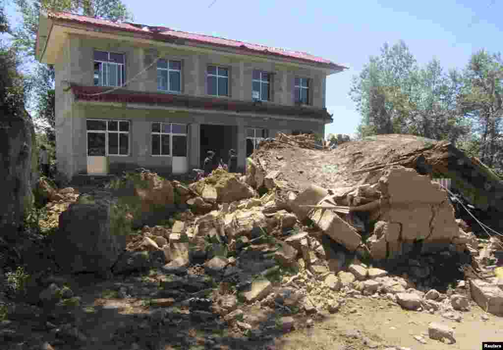 A destroyed house in the Dingxi region