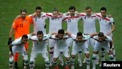 Iran's national soccer players pose for a team photo during their 2014 World Cup, June 25, 2014. Iran has again qualified for the 2018 World Cup.