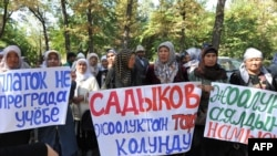 Women protest against a government ban on wearing Muslim head scarves in public schools in Bishkek on September 19.