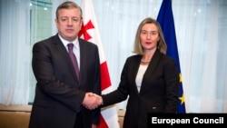 Georgian Prime Minister Giorgi Kvirikashvili (left) and EU foreign-policy chief Federica Mogherini pose during an EU-Georgia Association Council meeting in Brussels on February 5.