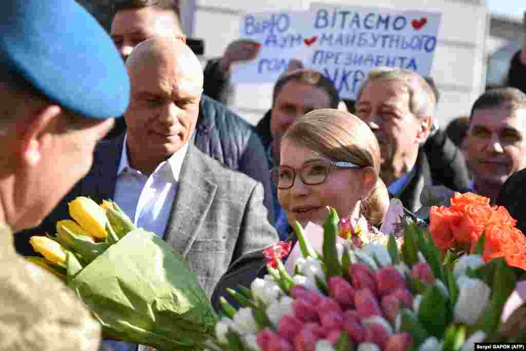 Former Ukrainian Prime Minister and presidential candidate Yulia Tymoshenko speaks with supporters outside a polling station after casting her ballot in Kyiv. (AFP / Sergei Gapon)