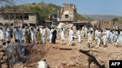 The site of the suicide car-bomb blast near the garrison city of Kohat