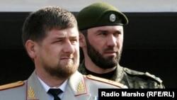 Magomed Daudov standing behind Chechen leader Ramzan Kadyrov