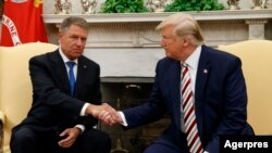 Romanin President Klaus Iohannis (left) and U.S. President Donald Trump at the White House on August 20.