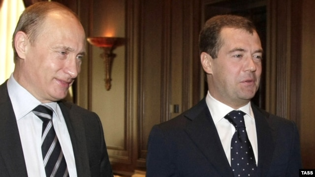 Russia's Prime Minster Vladimir Putin (left) and President Dmitry Medvedev -- more victims of the global economic crisis?