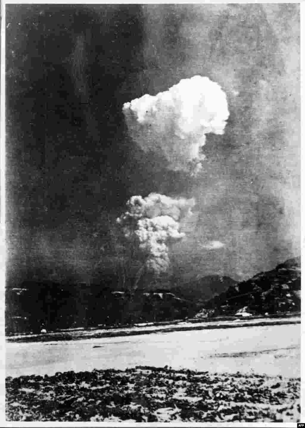 "This black-and-white photo provided on January 9 by the Honkawa Elementary School in Hiroshima, Japan, shows the mushroom cloud from the Hiroshima atomic bombing split in two. It is believed to have been taken about 30 minutes after the bombing on August 6, 1945, from a location some 10 kilometers east of the blast. ""The existence of this shot was always known in history books, but this is the first time that the actual print was discovered,"" said a curator at the Hiroshima Peace Memorial Museum. (AFP/Honkawa Elementary School)"