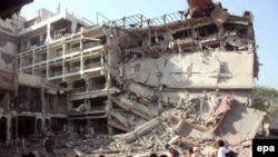 A large section of the Pearl Continental Hotel is in ruins after a suspected suicide bomb blast.