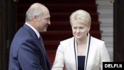 Lithuanian President Dalia Grybauskaite greets her Belarusian counterpart Alyaksandr Lukashenka in Vilnius.