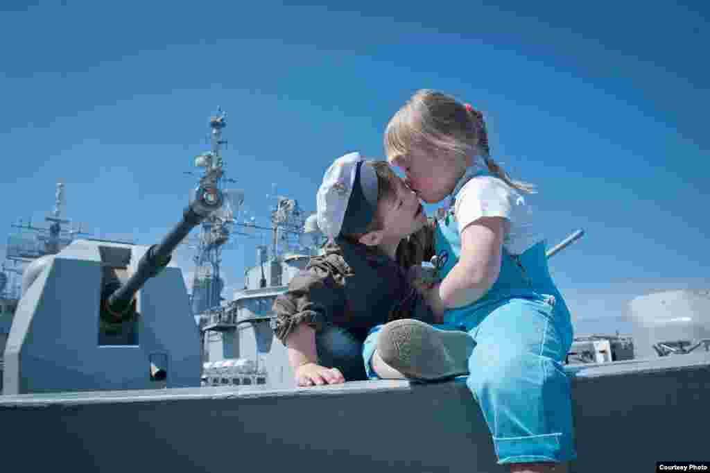 "Children with Down syndrome participating in a special tour of the ""HMS York,"" a British Royal Navy vessel docked in St. Petersburg, in July 2012. The excursion was organized for children from city orphanages and special schools."