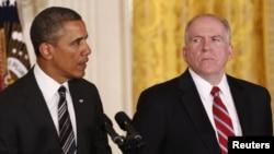 Președintele Barack Obama și fostul său consilier anti-terorism, John Brennan, la anunțul nominalizării directorului CIA