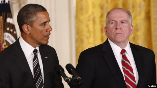 White House counterterrorism adviser John Brennan (right) listens as U.S. President Barack Obama nominates him to become the next CIA director at the White House in Washington on January 7.
