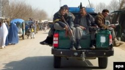 An Afghan police patrol in Konduz Province (file photo)