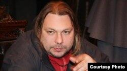 Андрэй Кудзіненка падчас здымкаў «Масакры»