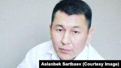 Асланбек Сартбаев.