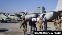 Special Inspector General John Sopko inspects the G222 fleet at Kabul International Airport in November 2013.