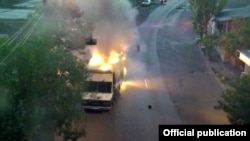 Armenia - A police vehicle which the Armenia police say was set on fire by opposition gunmen, 25Jul2016.
