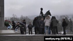 Kazakhs lay flowers to the Independence Monument in Almaty on December 17.