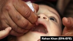 A health worker administers the polio vaccine to a child in Karachi on February 10.