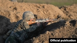 Nagorno-Karabakh - An Armenian soldier shoots during a military exercise, 20Nov2015.