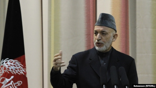 Afghan President Hamid Karzai speaks at Kabul's National Military Academy on February 16.