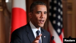 Japan -- US President Barack Obama gestures during a news conference at the Akasaka guesthouse in Tokyo, April 24, 2014