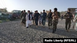 FILE: Afghan Officials inspect the aftermath of a suicide attack in the the province of Logar.